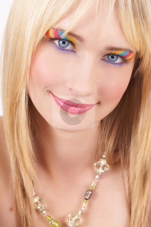 Portrait of beautiful blonde woman stock photo, Portrait of a beautiful blonde woman with light blue eyes and colorful make-up on white background by Elena Weber (nee Talberg)