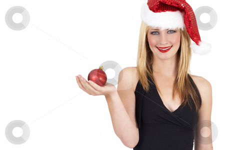 Portrait of beautiful blonde woman stock photo, Portrait of a beautiful blonde woman with light blue eyes and colorful make-up wearing Christmas hat and holding red ball isolated on white background by Elena Weber (nee Talberg)