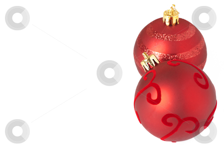 Red Christmas baubles stock photo, Two red Christmas baubles isolated on white background with copy space. Shallow depth of field by Elena Weber (nee Talberg)