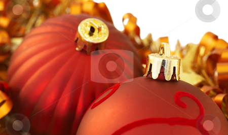 Red Christmas baubles stock photo, Two Red Christmas balls with ribbons and golden tinsel on white background. Shallow depth of field by Elena Weber (nee Talberg)