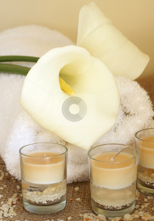 Relaxing spa scene stock photo, Relaxing spa scene with a white rolled up towel, white lillies, beautiful handmade candles and bath salts by Elena Weber (nee Talberg)