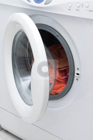 Washing machine stock photo, White washing machine with open door. by Elena Weber (nee Talberg)