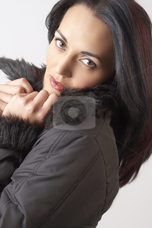 Portrait of beautiful brunette woman stock photo, Portrait of a beautiful mature brunette woman with dramatic make-up, wearing winter jacket with fur collar by Elena Weber (nee Talberg)