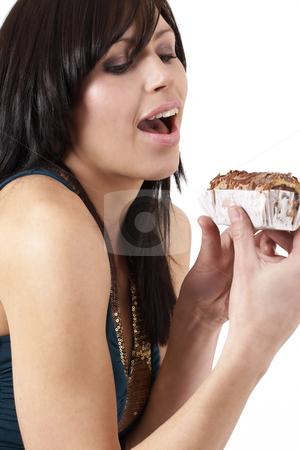 Portrait of beautiful brunette woman stock photo, Portrait of a beautiful young brunette woman tempted to eat a chocolate cake by Elena Weber (nee Talberg)