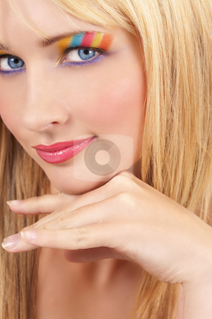 Portrait of beautiful blonde woman stock photo, Portrait of a beautiful blonde woman with light blue eyes and colorful make-up isolated on white background by Elena Weber (nee Talberg)