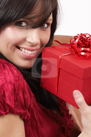 Portrait of beautiful brunette woman stock photo, Portrait of a beautiful young brunette woman holding gift box at a celebration by Elena Weber (nee Talberg)