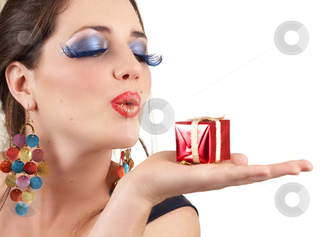Portrait of beautiful brunette woman stock photo, Portrait of a beautiful young brunette woman with dramatic glamour make-up and fashion earrings blowing a little gift box away by Elena Weber (nee Talberg)