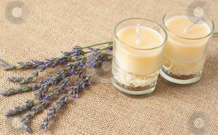Relaxing spa scene stock photo, Relaxing spa scene with a purple lavender and beautiful handmade candles on brown mesh material by Elena Weber (nee Talberg)