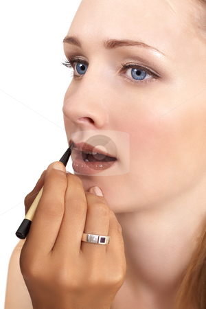 Portrait of beautiful blonde woman stock photo, Portrait of a beautiful blonde woman with light blue eyes and natural make-up being applied by make-up artist isolated on white background by Elena Weber (nee Talberg)