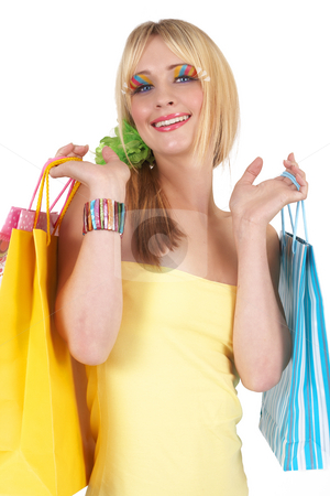 Portrait of beautiful blonde woman stock photo, Portrait of a beautiful blonde woman with light blue eyes and colorful make-up holding shopping bags isolated on white background by Elena Weber (nee Talberg)