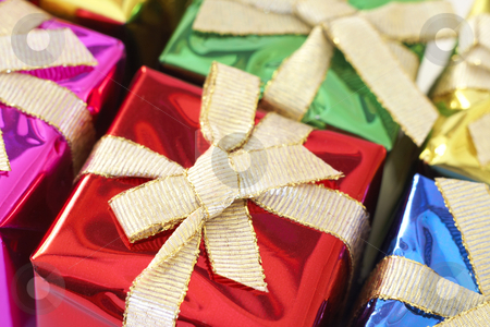 Colorful Christmas gifts stock photo, Colorful Christmas gifts wrapped in boxes with ribbons. Shallow depth of field by Elena Weber (nee Talberg)