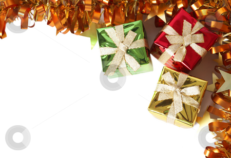 Colorful gift boxes and tinsel forming a frame stock photo, Colorful gift boxes and golden yellow tinsel isolated on white background with copy space forming a frame by Elena Weber (nee Talberg)