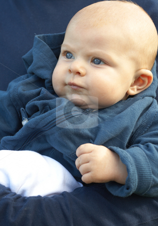 Small newborn baby in blue jacket stock photo, Small newborn baby sitting in his father's arms by Elena Weber (nee Talberg)