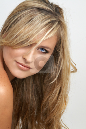 Portrait of beautiful blonde woman stock photo, Portrait of a beautiful blonde woman with light blue eyes and natural make-up on grey background by Elena Weber (nee Talberg)