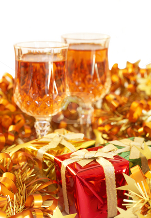 Colorful Christmas theme stock photo, Two glasses of sherry with gift boxes and golden tinsel on white background. Shallow depth of field by Elena Weber (nee Talberg)