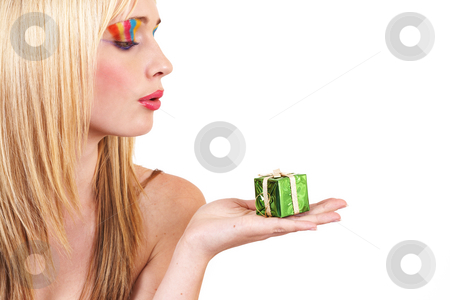 Portrait of beautiful blonde woman stock photo, Portrait of a beautiful blonde woman with light blue eyes and colorful make-up holding small Christmas box isolated on white background by Elena Weber (nee Talberg)