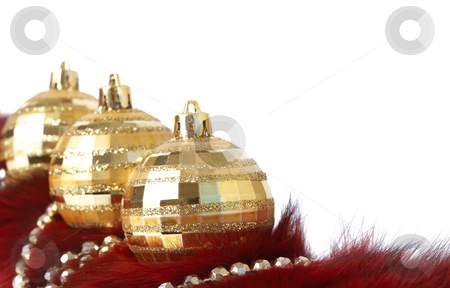 Gold Christmas baubles on fur stock photo, Three gold Christmas baubles lying on fur with gold beads isolated on white background with copy space. Shallow depth of field by Elena Weber (nee Talberg)