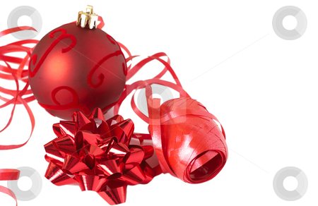 Red Christmas bauble with bow and ribbon stock photo, Red Christmas bauble with bow and ribbon on a roll isolated on white background by Elena Weber (nee Talberg)