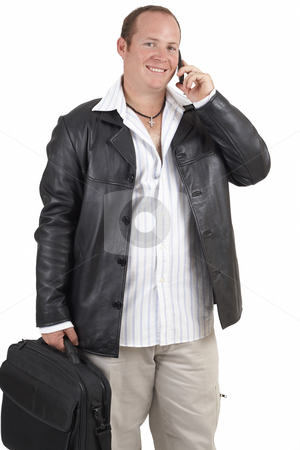 Businessman talking on a cellphone stock photo, Young successful businessman wearing leather jacket talking on a cellphone and smiling. Isolated on white background by Elena Weber (nee Talberg)