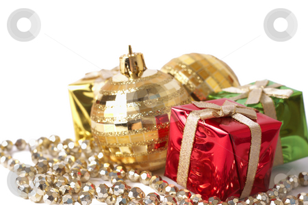 Christmas gift boxes, baubles and beads stock photo, Christmas gift boxes, gold baubles and beads isolated on white background with copy space by Elena Weber (nee Talberg)