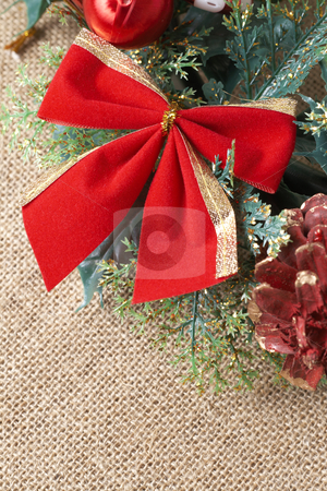 Colorful Christmas wreath stock photo, Colorful Christmas wreath with red bow, balls and pine cones on brown mesh background by Elena Weber (nee Talberg)