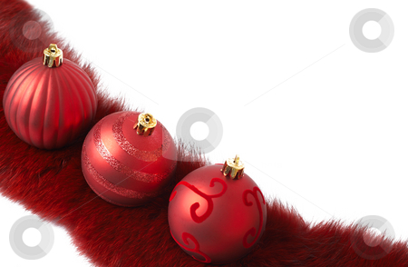 Three red Christmas baubles on fur stock photo, Three red Christmas baubles on luxurious fur isolated on white background with copy space. Shallow depth of field by Elena Weber (nee Talberg)