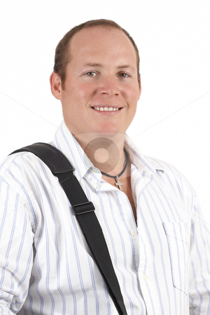 Smiling businessman stock photo, Young successful businessman wearing striped shirt with a laptop bag strap over his shoulder. Isolated on white background by Elena Weber (nee Talberg)