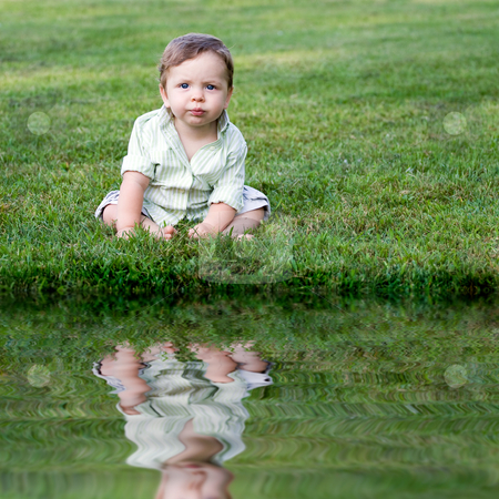 Cute Baby in the Grass stock photo, Cute young infant sitting in the grass all alone. by Todd Arena