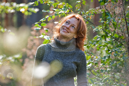 Portrait in nature stock photo, Portrait of red-haired adult women in nature by Roberts Ratuts