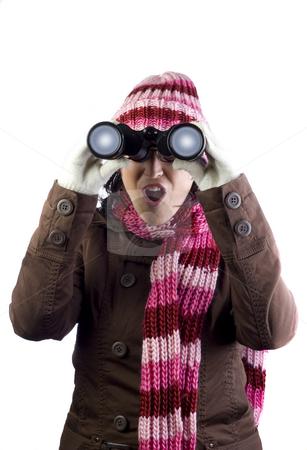 Christmas girl stock photo, Christmas woman holding and looking through binoculars by Ivan Montero