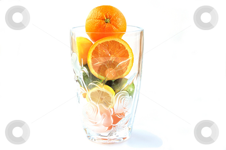 Oranges, lemons and limes in the big glass vase. stock photo, Oranges, lemons and limes in the big glass vase with clipping path. by Liana Bukhtyyarova