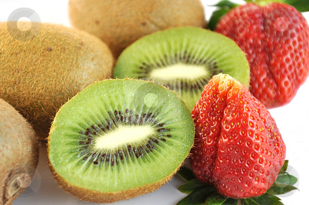 Kiwi and strawberry. stock photo, Kiwi and strawberry isolated over white. by Liana Bukhtyyarova