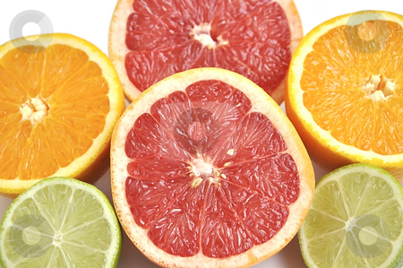 Background of grapefruit, orange and lime. stock photo, Background of cut grapefruit, orange and lime. by Liana Bukhtyyarova