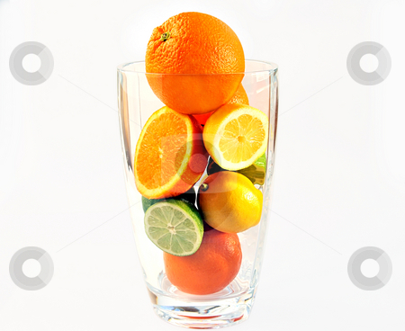 Oranges, lemons and limes in the big glass vase. stock photo, Oranges, lemons and limes in the big glass vase with clipping path ?? by Liana Bukhtyyarova