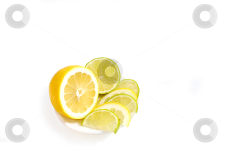 Slices of lemon and lime on saucer.  stock photo, Slices of lemon and lime on saucer isolated over white. by Liana Bukhtyyarova