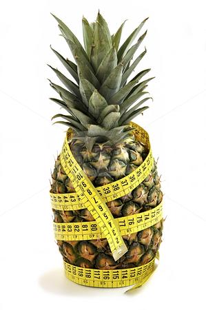 Pineapple with measuring tape. stock photo, Pineapple with measuring tape isolated over white. Diet concept. by Liana Bukhtyyarova
