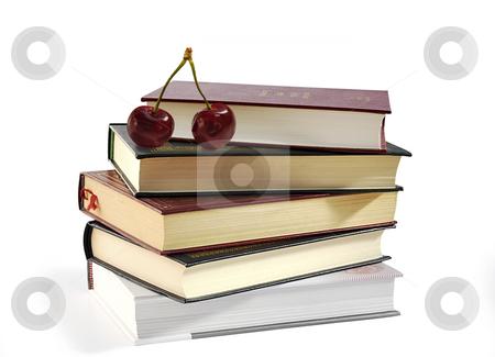 Pile of books and two sweet cherries. stock photo, Pile of books and two sweet cherries isolated over white. by Liana Bukhtyyarova