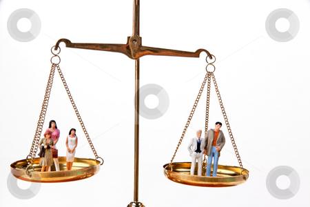 Dolls on Balancing Scales stock photo