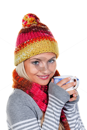 Young Woman in Winter Clothing Holding Mug stock photo, Young woman in winter clothing drinking from a mug. Vertically framed shot. by Erwin Johann Wodicka