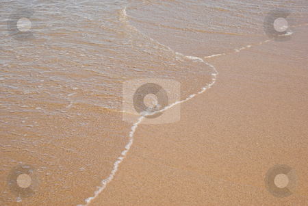 Gentle water stock photo, Peaceful and gentle water on the beach sand by Phil Morley