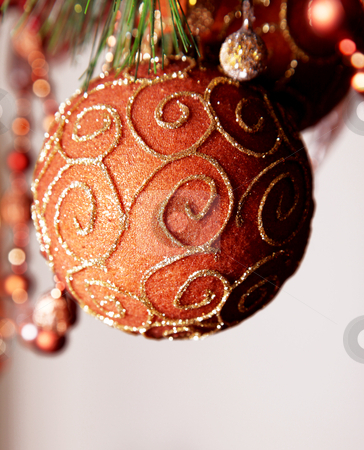 Ornament xmas stock photo, Red and gold christmas sphere on tree by Giuseppe Ramos
