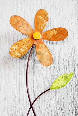 Flower stock photo, Orange ornament flower with green leaf over wall background by Giuseppe Ramos