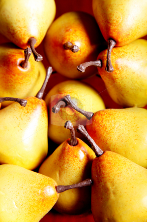 Fruits stock photo, Several yellow pears on a wooden surface by Giuseppe Ramos