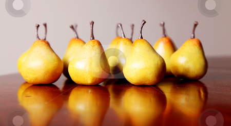 Pears stock photo, Several yellow pears on a wooden surface by Giuseppe Ramos