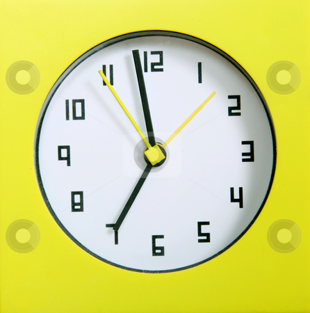Clock stock photo, Yellow clock with black numbers. Concept of time by Giuseppe Ramos