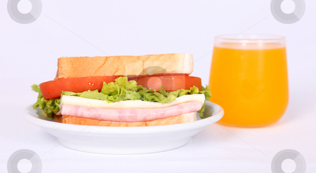 Breakfast stock photo, Breakfast, Sandwich with tomatoes, lettuce, ham and cheese, and orange juice by Giuseppe Ramos