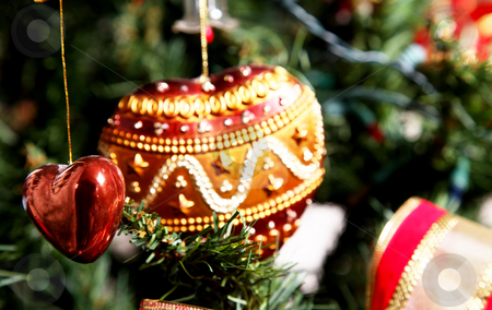 Love and christmas stock photo, Hearth christmas ornament on tree. Xmas image by Giuseppe Ramos
