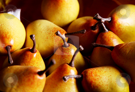 Yellow pears stock photo, Several yellow pears on a wooden surface by Giuseppe Ramos