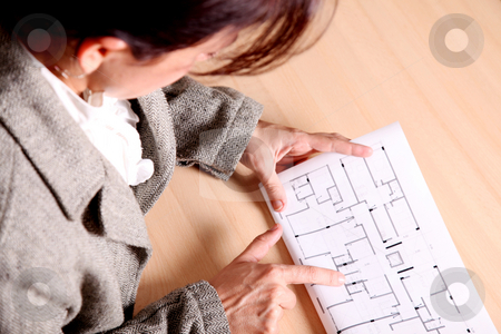Architecture stock photo, Woman pointing to some architectural drawings. Architecture image by Giuseppe Ramos
