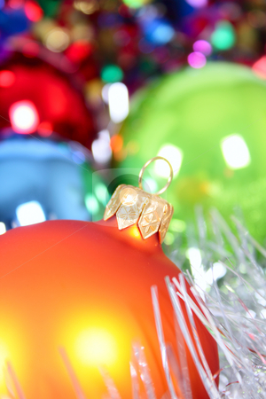Christmas-tree decorations stock photo, New Year's fur-tree toys against a multi-coloured tinsel removed close up by Andrey Efremov